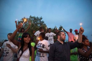 Protesters take part in a peaceful demonstration against shooting of Michael Brown, in Ferguson, Missouri
